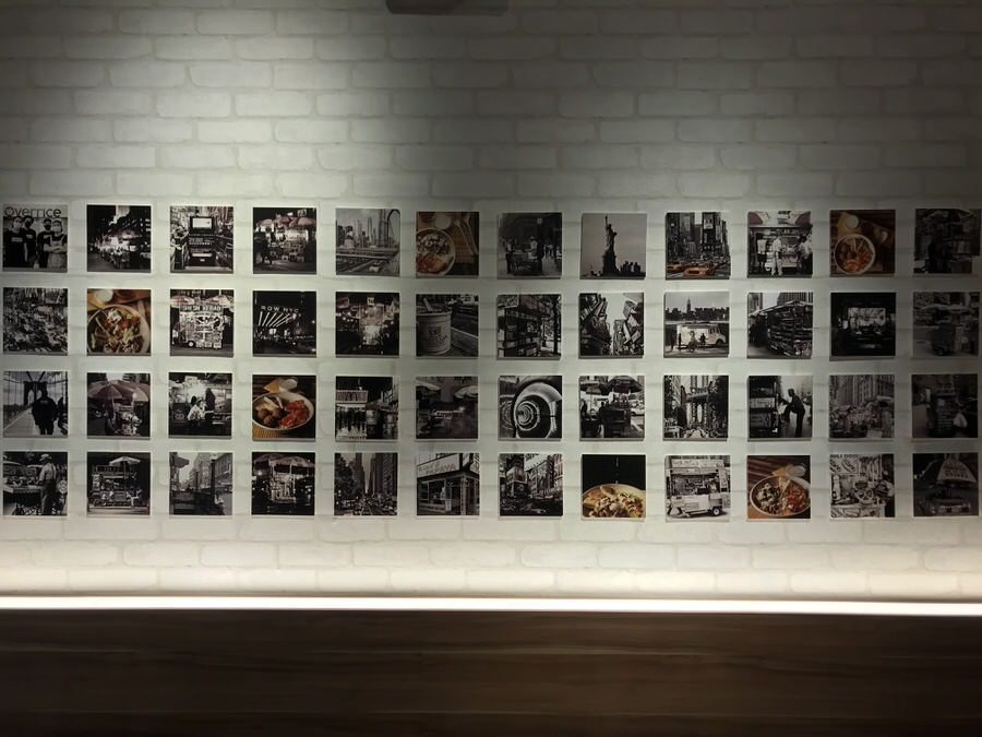 Photos of NYC line the wall